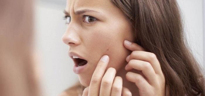 Жировик под кожей на лице